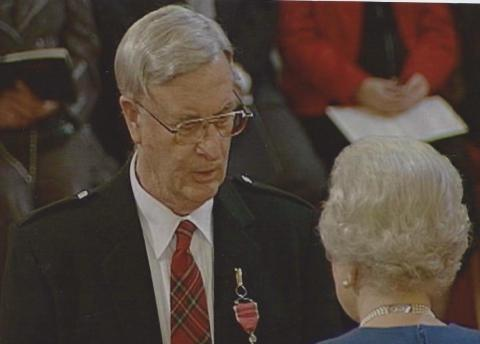 Alfred Stewart receives his MBE from Her Majesty the Queen